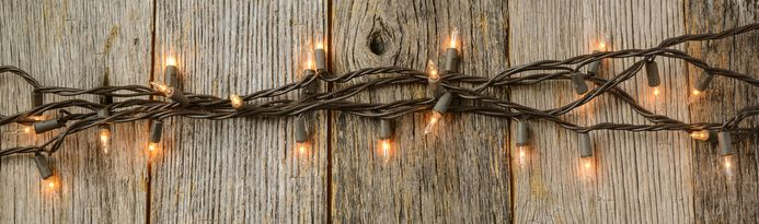 Whiite Christmas Tree Lights with Rustic Wood Background