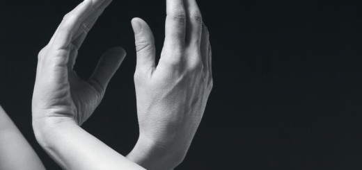 Monochrome image of two hands forming a link